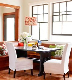 Use slipcovers to easily update your space! More tips here: http://www.bhg.com/kitchen/eat-in-kitchen/banquette-ideas/?socsrc=bhgpin072014savedbyslipcovers&page=3
