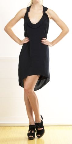 L'Agence Black Silk Dress with Ruched front neckline and ruffled backline. This is a comfortable silk dress that can be thrown on for the on-th-go woman. Ties at the top of the shoulders. Very cute hanging without shape, or belted to create a waist. 100% Silk.
