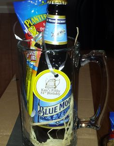 Adult Party Favor:  Really nice Beer Mug from Dollar Store, Rafia from walmart; the rest from grocery store.