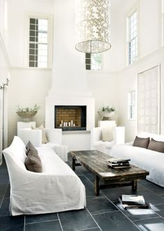 Great space high ceilings, fireplace and serene all-white color scheme.