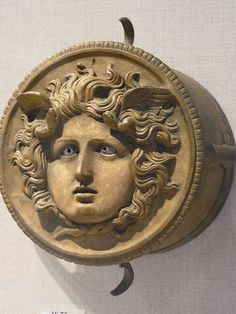 """Bronze ornament from a ceremonial chariot pole depicting Medusa Roman century CE"" [Mary Harrsch - Photographed at the Metropolitan Museum of Art] Medusa Gorgon, Roman 1, Green Man, Ancient Greece, Antique Art, Metropolitan Museum, Archaeology, Mythology, Old Things"
