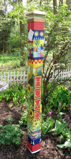"Our stunning Welcome Home garden peace art 64"" pole features a sunflower garden and colorful and picturesque houses. The whimsical design and bright colors will add a bit of unique magic to your landscape, lawn, or garden. A beautiful solar light crown for the pole is included with your purchase"