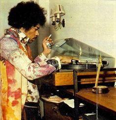 theswinginsixties:  Jimi Hendrix puts a record on.