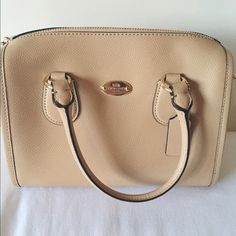 Authentic coach bag Authentic coach bag that has been used once or twice and is still in excellent condition! Comes with body strap and brown coach wristlet No trades LOWER PRICE ON MERC Also accepting️️ Coach Bags Shoulder Bags