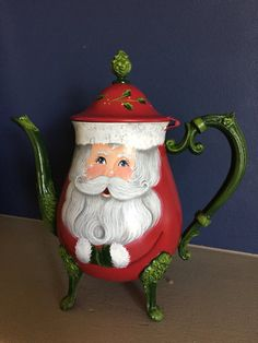 I hand painted a cute Santa with sparkling eyes on an old silver teapot. On the front, he has a face, arms and mittens. Christmas China, Christmas Dishes, Christmas Tablescapes, Christmas Tea, Christmas Kitchen, Christmas Holidays, Christmas Decorations, White Christmas, Painted Pots