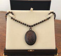 A Victorian Tortoiseshell Locket on hand carved Victorian Tortoiseshell beads.