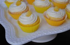 Perfect Lemon Cupcakes - add a package of lemon pudding and an extra 1/4 flour to reg. cake mix instructions