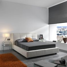 Leather bed works well with simple glass nightstands