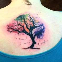 4 Colored Bare Tree Tattoo. Bare trees symbolizes the lost of the loved one. But the incorporation of different colors in the tattoo would mean the pounce back of happiness after the loss of the loved one.