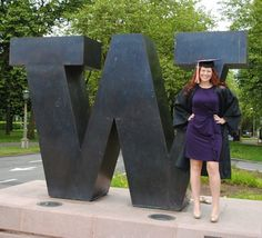 Graduation Day This photo was taken on graduation day.  Since the day I was accepted into the UW I knew I wanted my photo taken on graduation day in front of the W with my cap and gown.  I also had to wear a purple dress and gold shoes for the special occasion.  My dreams came true when I graduated from the UW, then went on to work for the UW.  Purple and Gold is in my blood Photo by Stacey Morrison