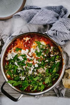 Shakshuka with Chevré & Fresh Herbs. One pot meal you can use as a breakfast, brunch or dinner recipe! Vegetarian, Paleo, Primal friendly recipe!