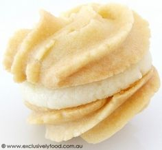 These rich, fine-textured, buttery biscuits have a sweet, lemony filling. Makes 20 filled biscuits. We use a 20ml tablespoon and 250ml m...