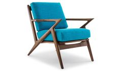 "Recalling distinct Danish and mid-century modern designs, the Soto is a work of art - that you can actually sit on. Inspired by the Danish-modern Selig ""Z"" chair, our Soto is the essence of mid-century sophistication. Hallmarked by its distinct silhouette, polished hardwood, and custom fabric or leather of your choice, it's sure to be an everlasting part of your furniture collection and a timeless investment in style. It's sure to become the seat everybody wants - all the time."