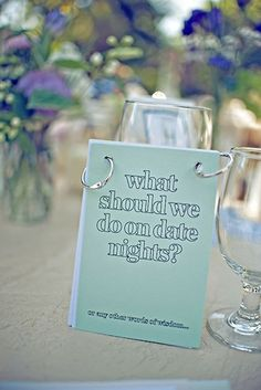 couple had these on each table for their guests add their favorite date night ideas