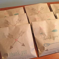 kraft favor bags with tribal arrow design by TigerLilyInvitations