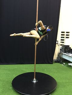 Pole dancer in Superwoman position, fitted with K5 wearable metabolic equipment for the measurement of oxygen consumption and other parameters.