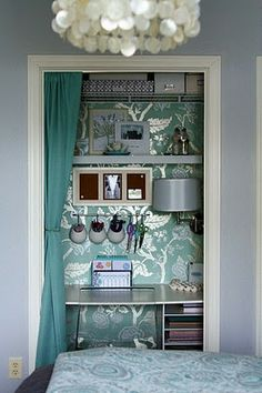 Adore the aqua wallpaper in close office. Curtain is smart.