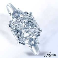 Style 2085 Platinum engagement ring is classically designed and features a stunning 3.01ct radiant diamond, highlighted by trapezoid diamonds #engagement #diamondring #radiant