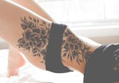 Love the flirty,girly vibe of flowers on the thigh. Maybe get a little smaller. Left side.
