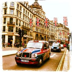 Taxi with Union Jack print on Regent Street London during Diamond Jubilee Celebration