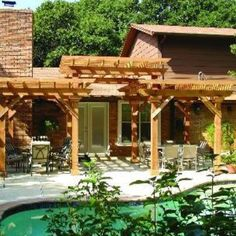 A shade structure can be as simple or as ornate as desired. This two level pergola provides the perfect spot to relax out of the hot sun after a dip in the pool.