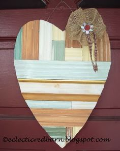 My Unordinary Valentine - how fun for the front door!  It could be made from paint sticks, pallet wood or even galvanized metal.#heart #uniquevalentine