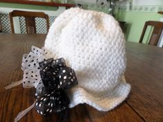 A crochet trilby style girls hat to fit 12 - 18 months old.It has a pleated top and a turned out brim with 2 sheer ribbon bows attached. Trilby Hat, Flower Spray, Dress Up Outfits, Girl With Hat, Ribbon Bows, Pale Pink, Little Girls, Winter Hats, My Etsy Shop