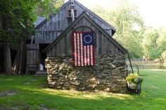 Colonial pride: If you live in (or have ties to) the original 13 colonies, why not show your pride by flying the original flag? It fits right in on this old barn. | Living the Country Life   | http://www.livingthecountrylife.com/homes-acreages/country-homes/19-american-scenes/http://www.livingthecountrylife.com/homes-acreages/country-homes/19-american-scenes/