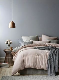 Stylish bedroom. Beautiful colors: pale pink and gray.