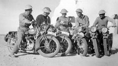The Italian Offensive 1940 - 1941: British troops, sitting on captured Italian motorcycles, read copies of the congratulatory telegram sent to all units after their victory by the Secretary of State for War, Mr Anthony Eden.