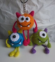 Crochet Pattern Ball Monster Keychain : Hi! The little ball monsters would like to make your life more colorful. Whether as a keychain, bag charm or lucky charm, the little guys are made fast and conjure a smile in every face. They are also excellent Crochet Amigurumi, Amigurumi Patterns, Crochet Dolls, Knitting Patterns, Crochet Patterns, Afghan Patterns, Crochet Ideas, Crochet Monsters, Crochet Animals