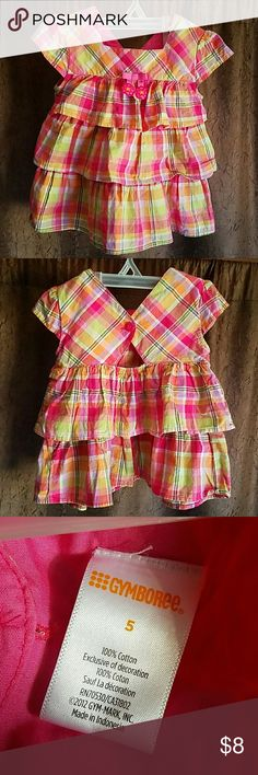 Gymboree Pink Plaid Ruffled Short Sleeved Top 5T Gymboree Pink Plaid Ruffled Short Sleeved Top 5T. Buttons in back. Has bow and two heart appliques in front. It is also lined with pink fabric to prevent thinness in the overall shirt. Very cute for back to school! EUC. Only washed with fragrance free detergent. Gymboree Shirts & Tops Blouses