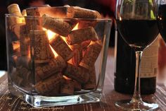 Wine corks spruce up any glass container with a candle for a vineyard wedding. | Green Bride Guide
