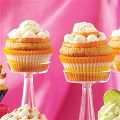 Orange Cream-Filled Cupcakes Recipe -Our home economists bring the flavor of a favorite frozen treat to palate-pleasing cupcakes. A scoop of vanilla ice cream adds even more indulgence!
