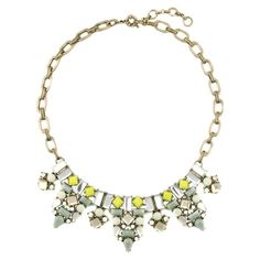 Add a pop of style to evening ensembles and work outfits alike with this gold-plated necklace, showcasing a bib of colorful stones for vibrant appeal.