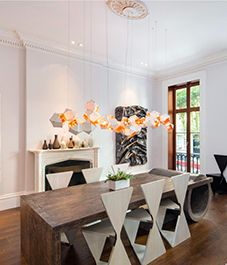 Celeb home tour: Sarah Jessica Parker's Greenwich Village townhouse modular design unique shaped table in contemporary dining space
