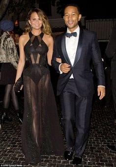 Sheer inspiration: Chrissy Teigen captivated in her sheer black gown as at a Grammys after-party at Chateau Marmont in West Hollywood with h...