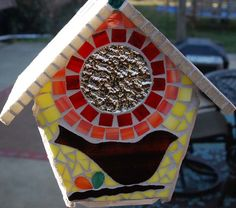 since birdhouses make every house a home, how could someone not fall in LOVE with this mosaic one? so adorable.