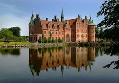Egeskov Slot, Denmark....I would LOVE to go to Denmark someday...especially since I have so much Danish heritage.