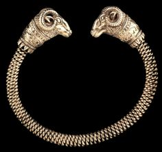 Achaemenid Persian Ram-Headed Gold Bracelet.  Ancient Persia, 5th - 4th Century BC  These styles of bracelets can be traced back to Persepolis, the capital city of ancient Persia and were usually found in the ancient Royal courts, likely as a tribute to the King.