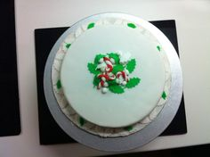 Holly and candy cane Christmas cake