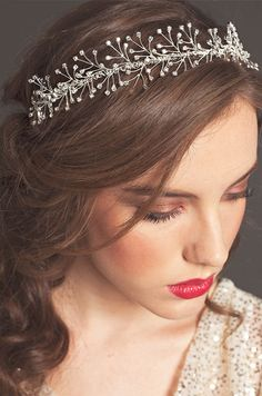 A beautiful bride wears the Rhinestone Garland wedding headband from the Sarah Seven Fall 2013 collection.