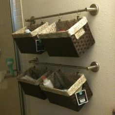 DIY Extra Bathroom Storage Idea - When you need more space to store your bathroom stuff use towel rods to hang wicker baskets and fill!