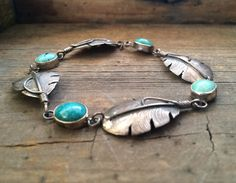 Signed vintage Lena Platero sterling silver and turquoise feather link bracelet, Native American jewelry, vintage Navajo turquoise bracelet by romaarellano on Etsy https://www.etsy.com/listing/266263342/signed-vintage-lena-platero-sterling