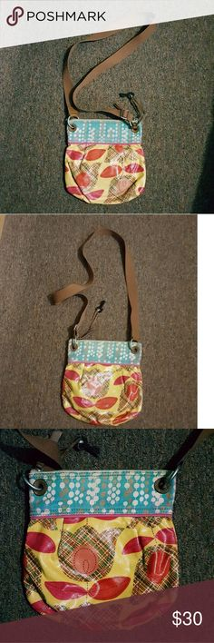 Fossil Crossbody Floral Coated Canvas Bag FOSSIL KEYPER CROSSBODY BAG  * YELLOW WITH TULIP PRINT COATED CANVAS * PLEATED TOP  * LEATHER TRIM  * TOP IS CAVAS DOT PRINT  * CROSSBODY STRAP  * ZIP CLOSURE  * CLEAN INTERIOR  * VERY LITTLE WEAR ON THE CANVAS AND SMALL SPOT ON TULIP PRINT   11 X 11 Fossil Bags Crossbody Bags