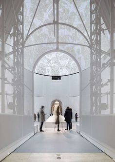 """Walk through the galleries of the Met's newly opened """"Manus x Machina: Fashion in an Age of Technology"""" exhibition to the soundtrack of Brian Eno's 1978 """"Amb..."""