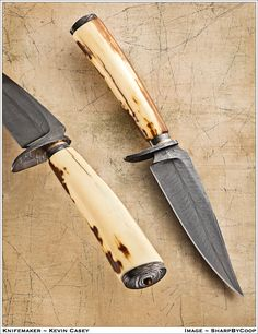 "Kevin Cavin Feather Damascus Knife Walrus Tusk Handle  4.75"" Casey Feather Damascus blade. OAL 9"".  Casey Damascus guard and spacer w/bronze.   Fossilized Walrus Tusk handle.   Casey Damascus pommel with inlaid Tiger Eye stone."
