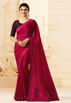 Faux Georgette Saree in Fuchsia This Drape is Enhanced with Stone and Patch Border Work Available with a Semi-stitched Art Silk Blouse in Wine. Crafted in Round Neck and Half Sleeve. Blouse Length- 14 to 15 inches and Sleeve Length- 1 to 10 inches Free Services: Fall and Edging (Pico) Do note: Accessories shown in the image are for presentation purposes only.(Slight variation in actual color vs. image is possible).