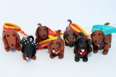 "I made this pack of polymer clay Dachshund ornaments for a show benefiting the CTDR, Central Texas Dachshund Rescue. It's called ""Winter Weinerland Bazaar""."