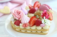 Trendy Cream Tarts -close-up shot of a single cream biscuit topped with fresh berries, meringues, flowers, and more | From SugarHero.com